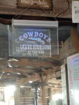 Cowboys, leave your guns at the bar... for the safety of our patrons!